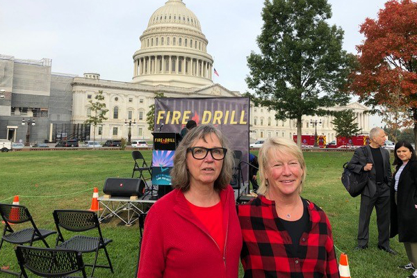 Kathy Mehuron, left, and Alice Rodgers were among the Fire Drill Friday demonstrators in Washington, DC.