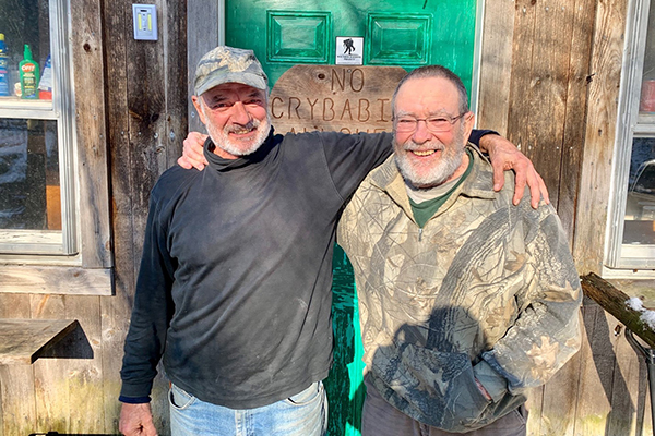 Photo: Hadley Laskowski. From left to right: John Dezotelle, a deer camp regular, and Mike Mackenzie, one of the original founders of the camp on North Fayston Road.