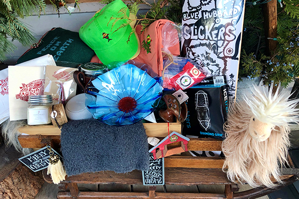 Photo: Marnie Davis. Historic Waitsfield Village businesses contributed goods for a basket for the Country Christmas raffle which benefits the Mad River Valley Food Shelf. Tickets can be purchased at 4orty Bridge Boutique or at the Mad River Valley Chamber office. The raffle will be drawn on Saturday, December 7, at 5 p.m.