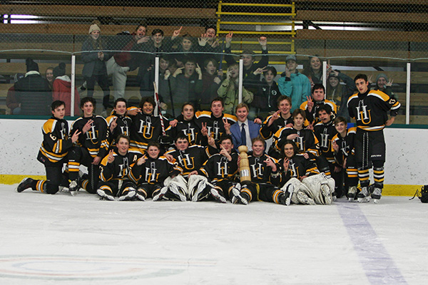 Harwood's boys' varsity hockey team won the Charlie Burchard Memorial Hockey Tournament for the second straight year.