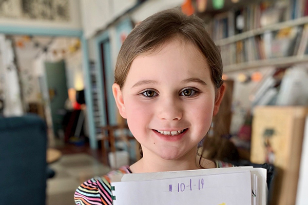 "Photo: Hadley Laskowski. Julia Hill proudly displays her close-up drawing of a leaf. ""I love the outdoors and animals,"" Julia  said. ""I love 'em. They're just really important. Cuz if we didn't have animals, what would happen?"""