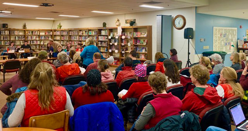 Educators and community members wore red in support of education at a February 12 school board meeting.