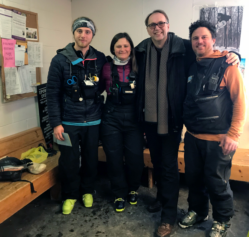Sugarbush ski patrollers Andreas Panos, Allie Burhans and Leo Crain flank Martin, second from right, on February 15 when he  returned to Mt. Ellen to thank them for saving his life. Photo: Chad Borofsky.