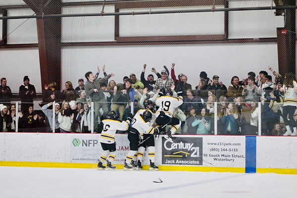 The Harwood boys' hockey team celebrates with their fans their win over Missisquoi. Photo: Ingrid Lackey-Howell.