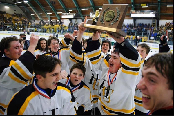 The Harwood boys' hockey team celebrates their D2 championship. Photo: Brian Jenkins.