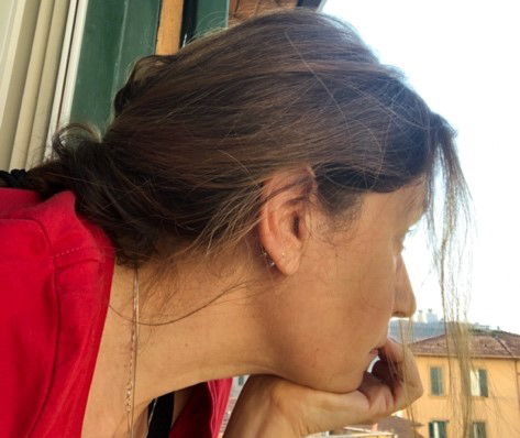 Tina Rocchio looking out her window in Rome, Italy.