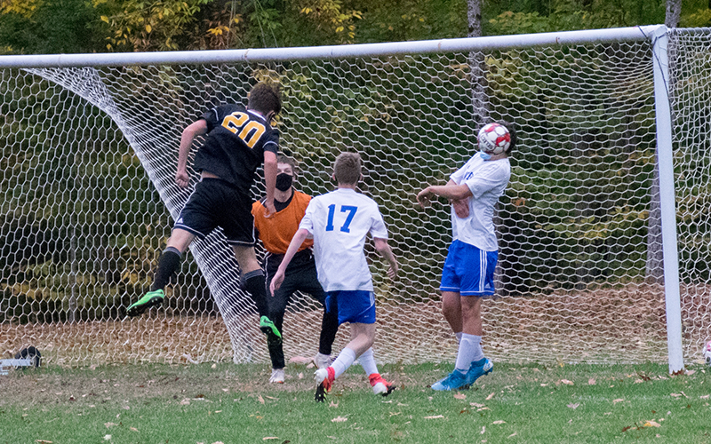 Nicolas Moran attempts a header during the first half of Tuesday's match against Thetford Academy. Harwood won 4-0. Photo: Jeff Knight