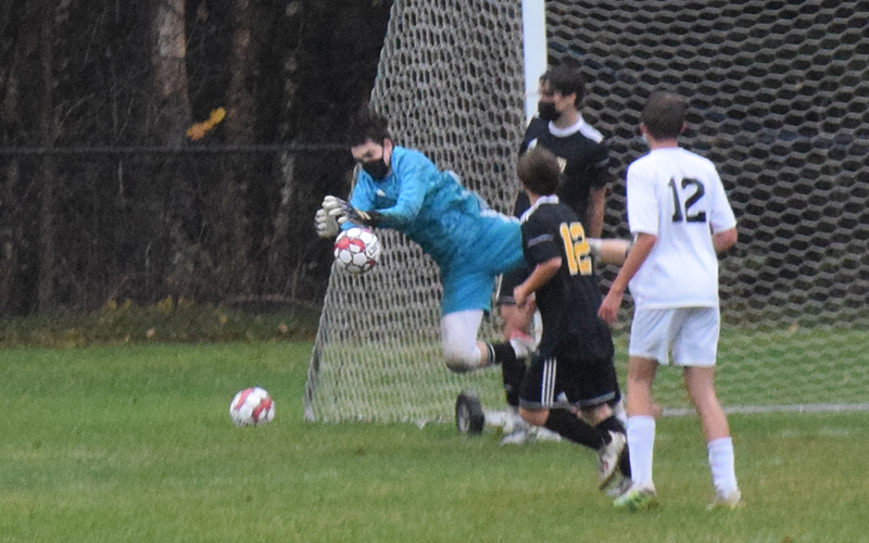 Harwood goalie Jake Collier makes a save during the first half of Harwood versus Stowe on Tuesday, October 20. Stowe won 3-2. Photo: Jeff Knight