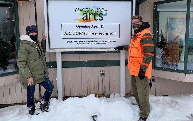 Mad River Valley Arts executive director Kira Bacon and director of exhibitions Gary Eckhart put the finishing touches on the new sign at the gallery in the Village Square Shopping Center. Photo: June Anderson.