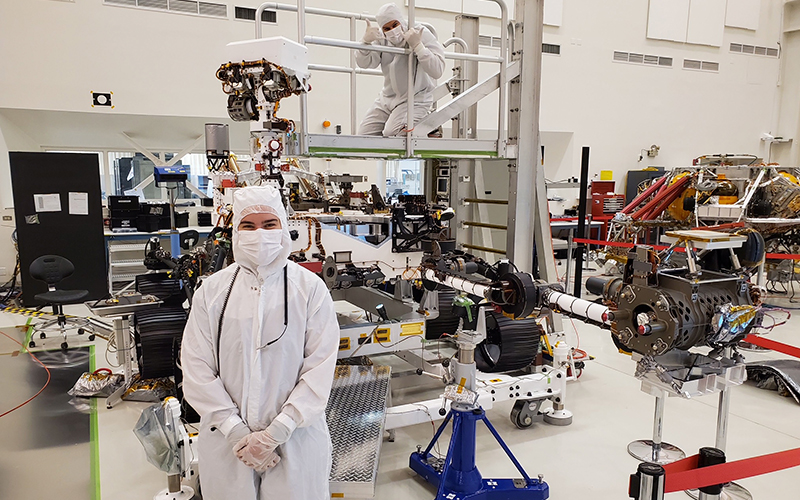 Emmy Kelly stands in front of the Perseverance rover at the NASA jet Propulsion Laboratory (JPL) in California. Photo courtesy Emma Kelly.