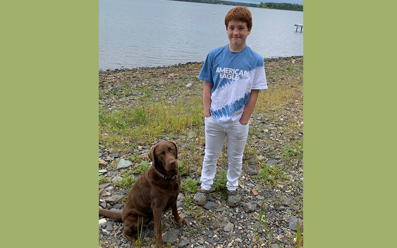 Aiden Heath, pictured with his dog Angel, has type 1 diabetes and wants to be vaccinated but because he is under 16 he is not eligible.