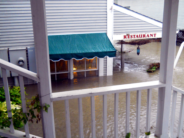 Lights still on as floodwaters inundate Waitsfield buildings during Tropical Storm Irene
